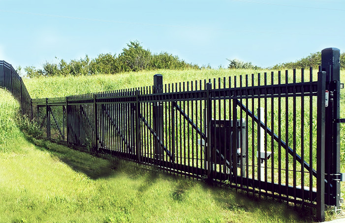 Black ornamental cantilever gate with slide driver gate operator